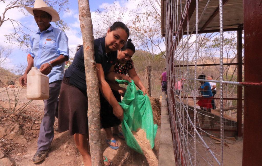 Women pouring gravel_for blog